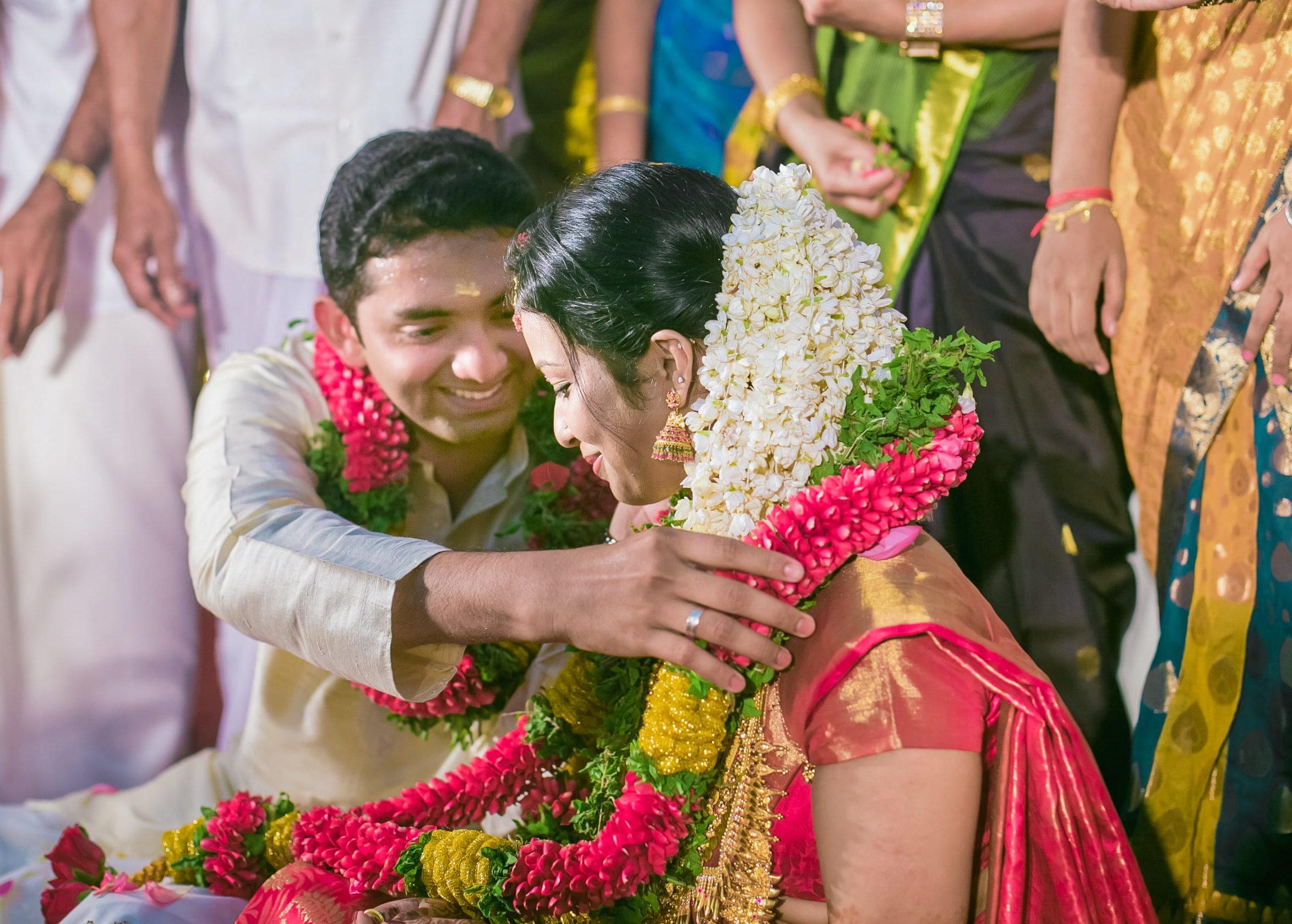 The happy bride and grrom during maala maattal