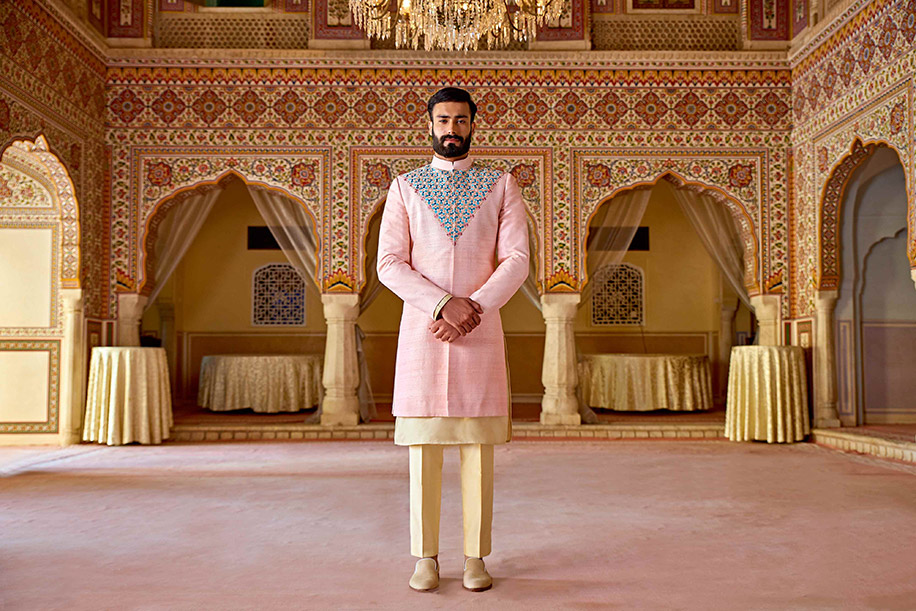 Groom in pink sherwani